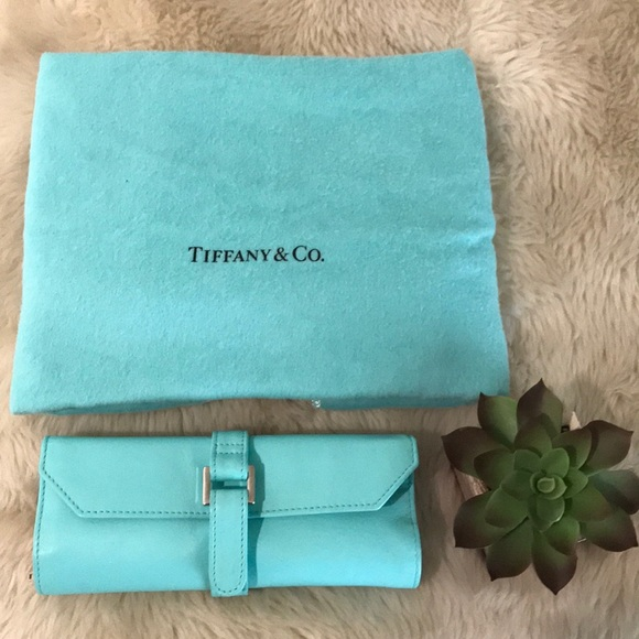 6adb8283a4 Tiffany & Co leather travel jewelry roll tco blue.  M_5ac1187f8af1c5b1b22f3e55